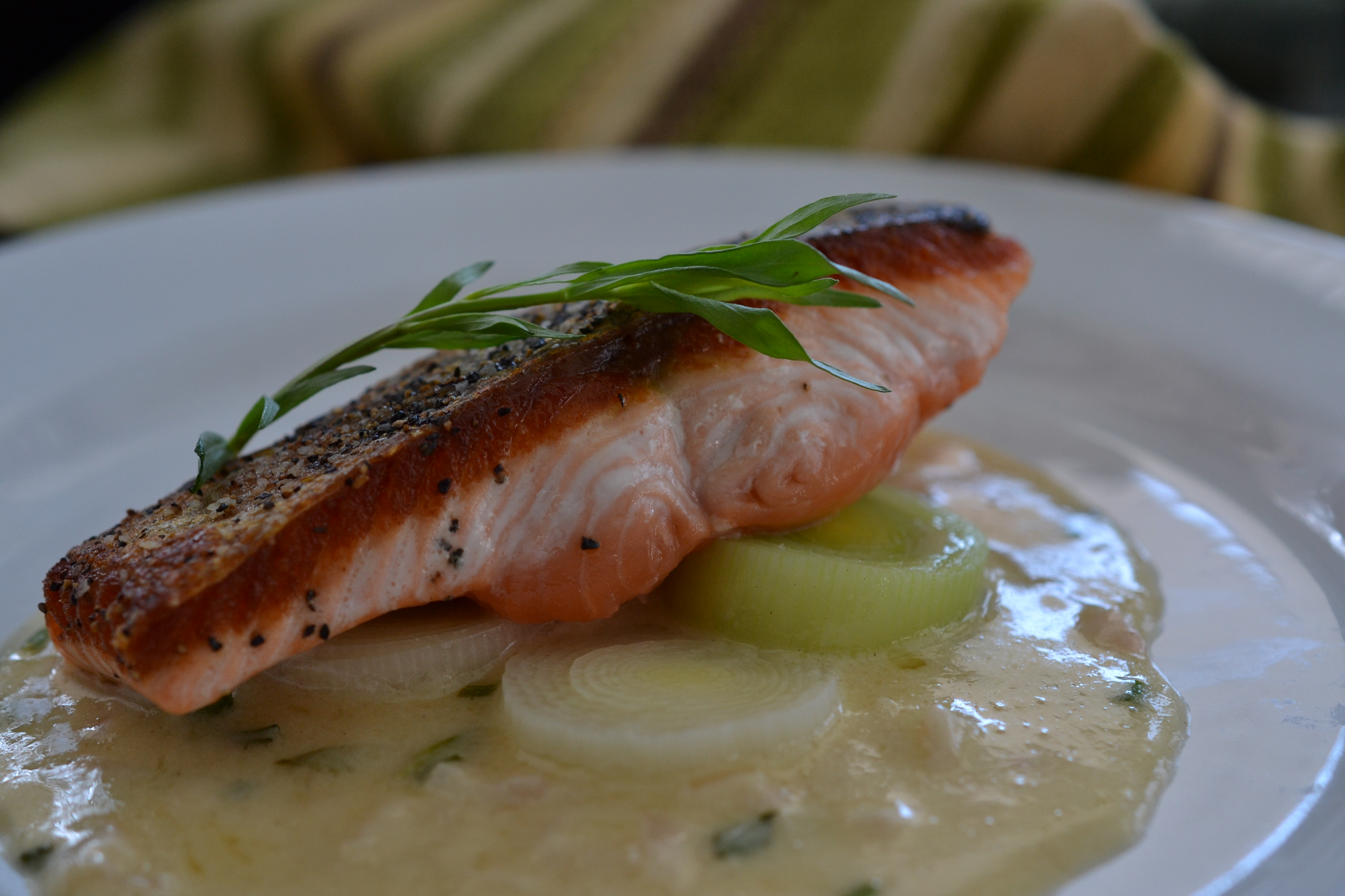 crispy salmon with leeks and beurre blanc sauce shredded sprout